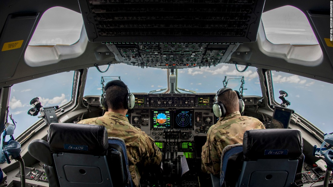 Air Force Capts. Bryan Adams, left, and David Wilfong fly a C-17 Globemaster III to Puerto Rico on Saturday, September 9. They were delivering personnel and equipment to help with Hurricane Irma relief efforts.