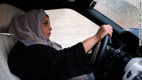 A Saudi woman drives her car along a street in the Saudi coastal city of Jeddah, on September 27, 2017.  Saudi Arabia will allow women to drive from next June, state media said on September 26, 2017 in a historic decision that makes the Gulf kingdom the last country in the world to permit women behind the wheel.  / AFP PHOTO / Reem BAESHEN        (Photo credit should read REEM BAESHEN/AFP/Getty Images)