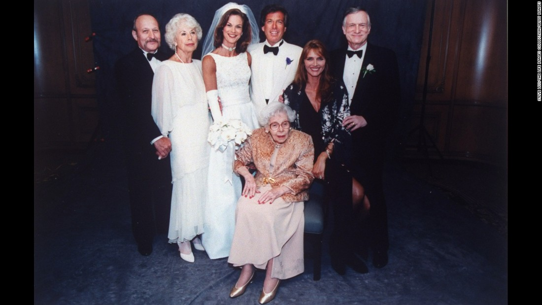 Hefner poses with his daughter Christie, then CEO of Playboy, at her wedding to former Illinois state senator William Marovitz in 1995.
