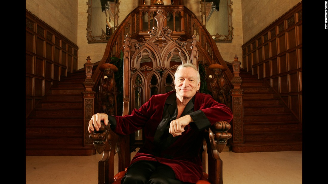 "Hefner built himself into an icon, along with the Playboy Mansion, in which he posed for this November 2005 photo. The building was <a href=""http://money.cnn.com/2016/08/17/real_estate/playboy-mansion-sale/index.html"">sold for $100 million in 2016</a>, but Hefner remained living there until his death."
