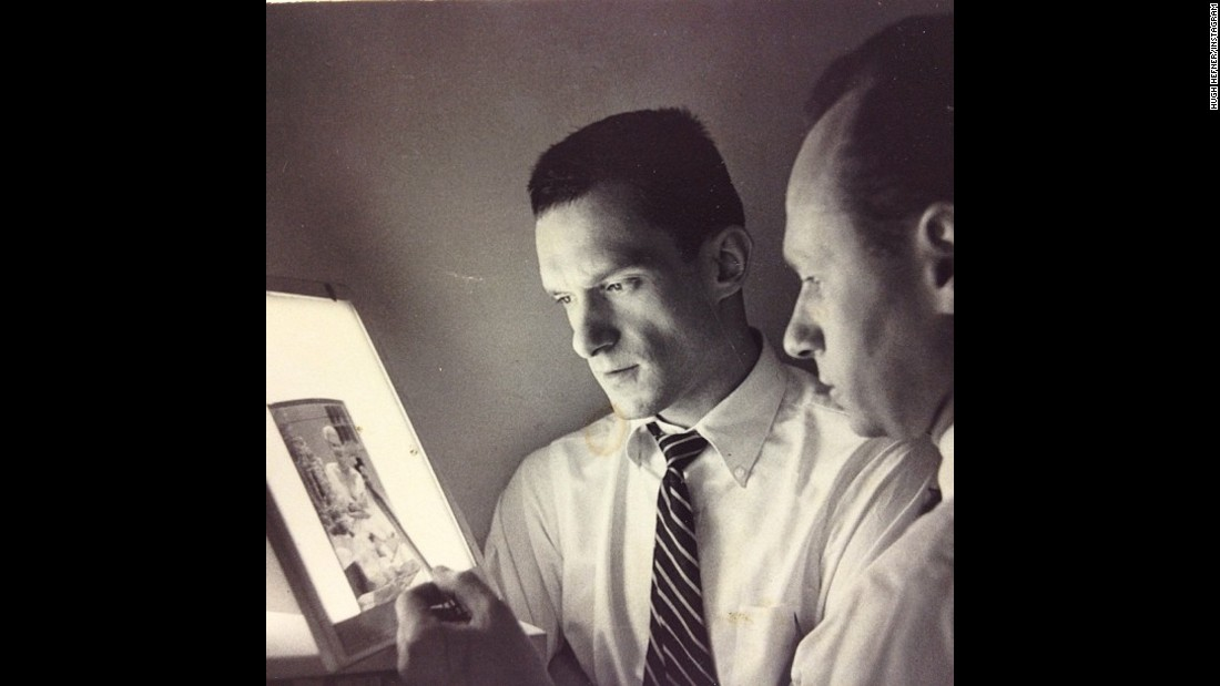 Hefner, left, reviews a negative in 1955.
