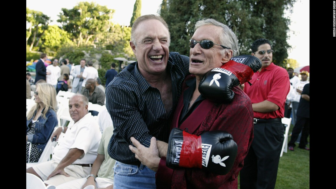 Hefner seen with actor James Cann during Fight Night at the Playboy Mansion on July 15, 2003.