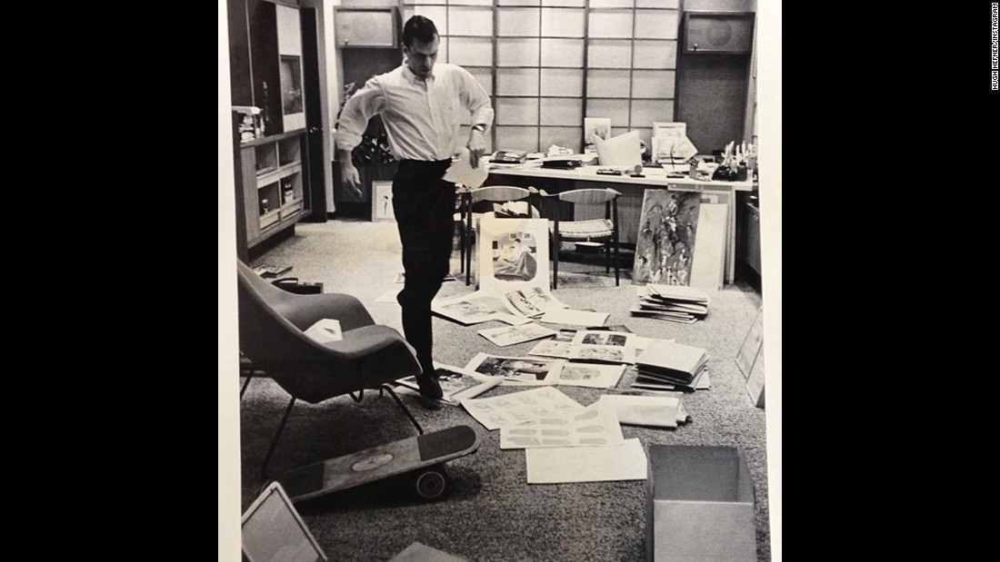 Hefner was intimately involved in the early days of Playboy magazine. This photo shared by him on Instagram shows Hefner hopping through a chaos of paper in his office to take a phone call in 1962.