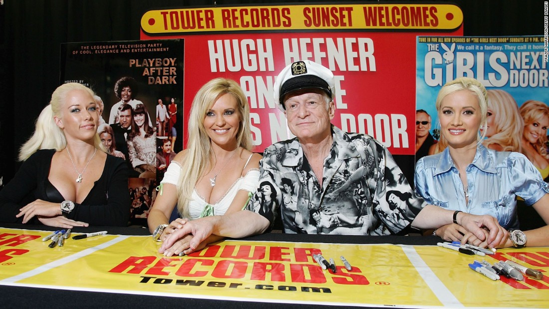 "Hefner poses with Kendra Wilkinson, Bridget Marquardt and Holly Madison at a signing for DVDs of their reality show ""Hugh Hefner And the Girls Next Door"" in August 2006."