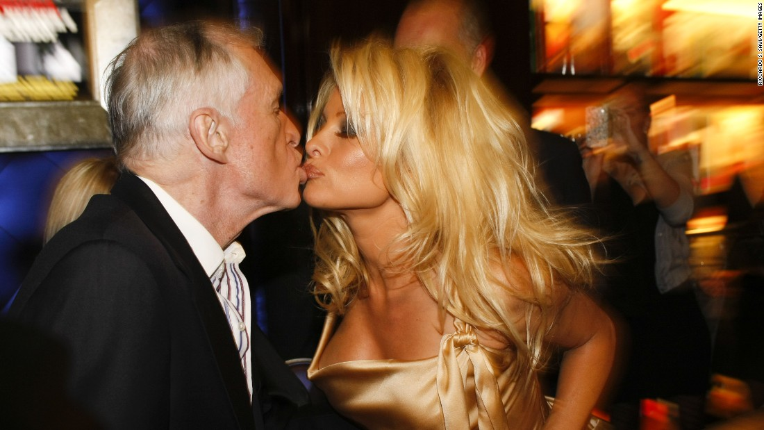 Hugh Hefner and Pamela Anderson attend a book signing session at Taschen on December 10, 2009 in Beverly Hills, California.