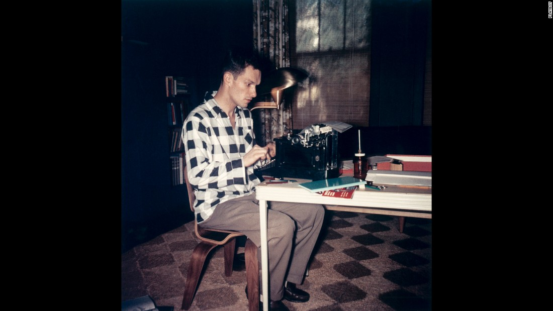 Hugh Hefner works on a typewriter in an undated file photo. Between 1951-1952, Hefner worked as a promotional copywriter for Esquire magazine.