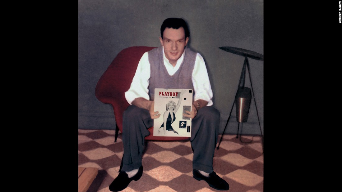 Hugh Hefner poses with the first issue of Playboy in 1953. It featured a nude calendar photo of Marilyn Monroe and sold more than 50,000 copies.
