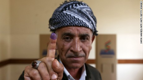 TOPSHOT - An Iraqi Kurdish man shows his ink-stained finger after voting in the Kurdish independence referendum in Arbil, the capital of the autonomous Kurdish region of northern Iraq, on September 25, 2017. / AFP PHOTO / SAFIN HAMED        (Photo credit should read SAFIN HAMED/AFP/Getty Images)