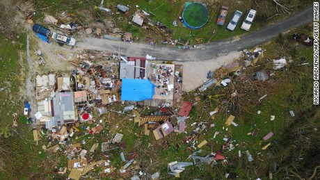 A house destroyed by hurricane winds is seen in Corozal, west of San Juan, Puerto Rico, on September 24, 2017 following the passage of Hurricane Maria. Authorities in Puerto Rico rushed on September 23, 2017 to evacuate people living downriver from a dam said to be in danger of collapsing because of flooding from Hurricane Maria. / AFP PHOTO / Ricardo ARDUENGO        (Photo credit should read RICARDO ARDUENGO/AFP/Getty Images)