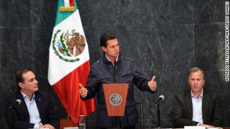 Mexican President Enrique Pena Nieto (C) speaks along Juan Pablo Castanon (L) from the Consejo Coordinador Empresarial (Businessmen's Coordinating Council) and Mexican Finance Minister Jose Antonio Meade (R) during a message on the most recent earthquake, in Mexico City on September 27, 2017.  Faced with a tragedy that battered the city and claimed more than 300 lives, Mexico put its best foot forward, responding with an explosion of civic action. / AFP PHOTO / ALFREDO ESTRELLA        (Photo credit should read ALFREDO ESTRELLA/AFP/Getty Images)