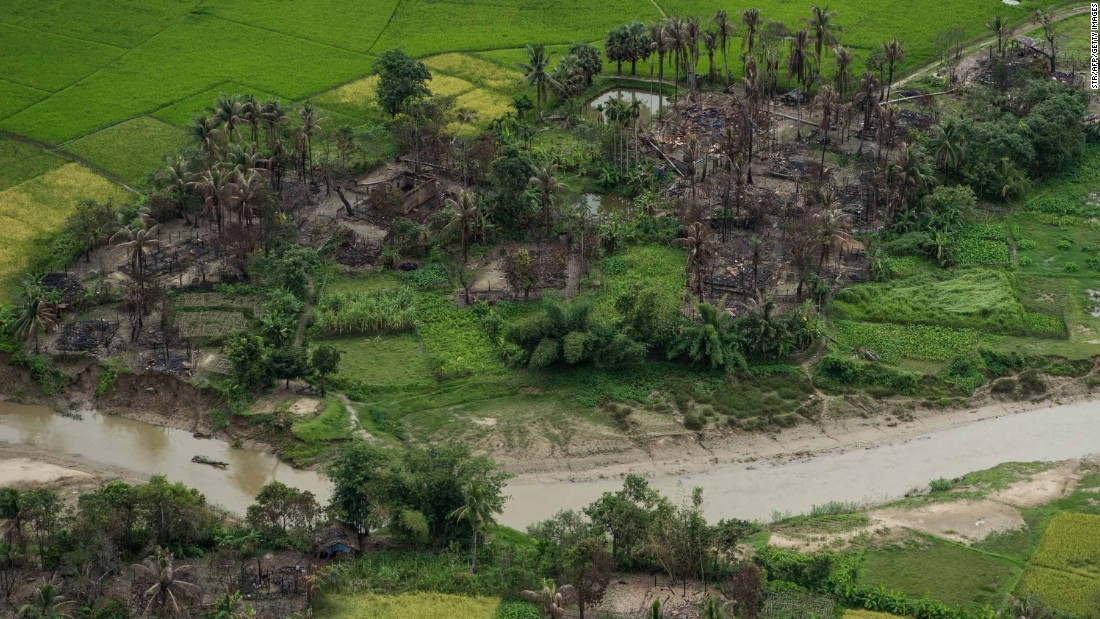Burnt villages are seen on September 27, near Maungdaw in Myanmar's northern Rakhine state.