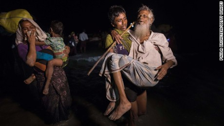 Hundreds of Rohingya arrive by boats in the safety of darkness on September 26, 2017 on Shah Porir Dwip island, Cox's Bazar, Bangladesh.