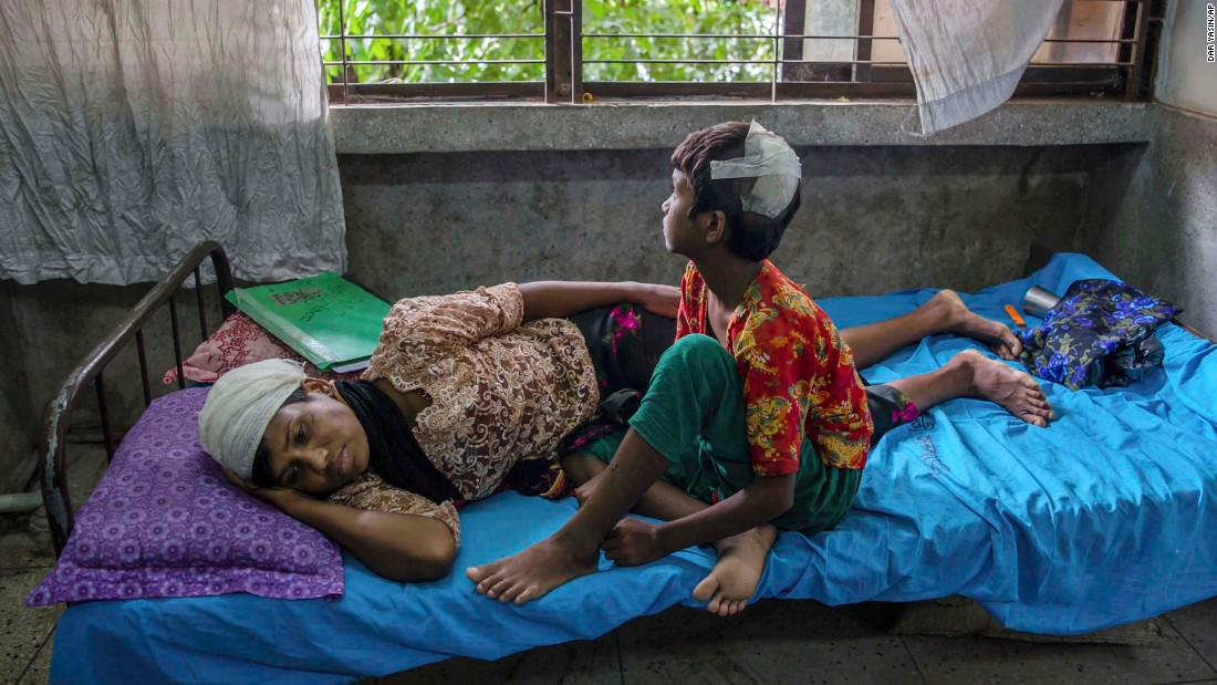 Dildar Begum, a Rohingya woman, and her daughter, Noor Kalima, recover from injuries at Sadar Hospital in Cox's Bazar, Bangladesh, after fleeing their home in Rakhine state. Begum said her husband was killed and she and her daughter were attacked by Burmese soldiers.