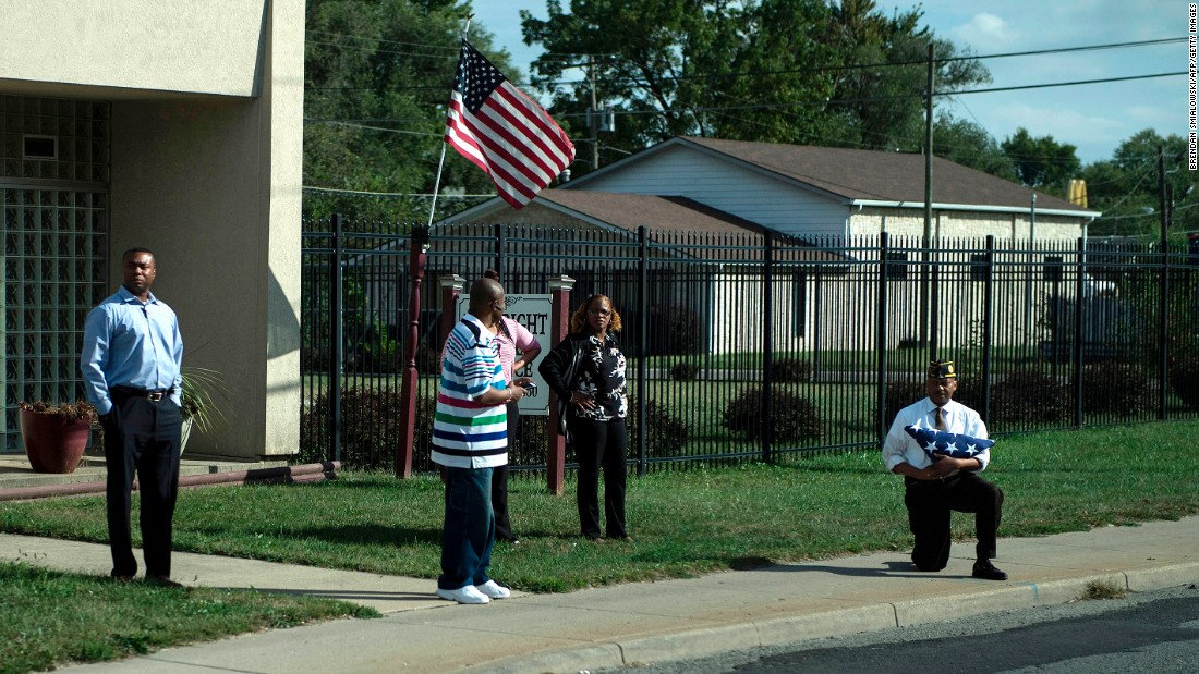 "A man holding an American flag <a href=""http://www.cnn.com/2017/09/28/us/trump-motorcade-man-on-knee-photo-trnd/index.html"" target=""_blank"">kneels as US President Donald Trump's motorcade passes</a> after an event at the state fairgrounds in Indianapolis on Wednesday, September 27. After Trump criticized football players who kneel during ""The Star-Spangled Banner"" to protest police brutality, there have been numerous instances of veterans, athletes and others taking a knee in solidarity. There has also been a <a href=""http://www.cnn.com/2017/09/25/us/anthem-protests-burning-nfl-jerseys-trnd/index.html"" target=""_blank"">backlash over the protests</a>."