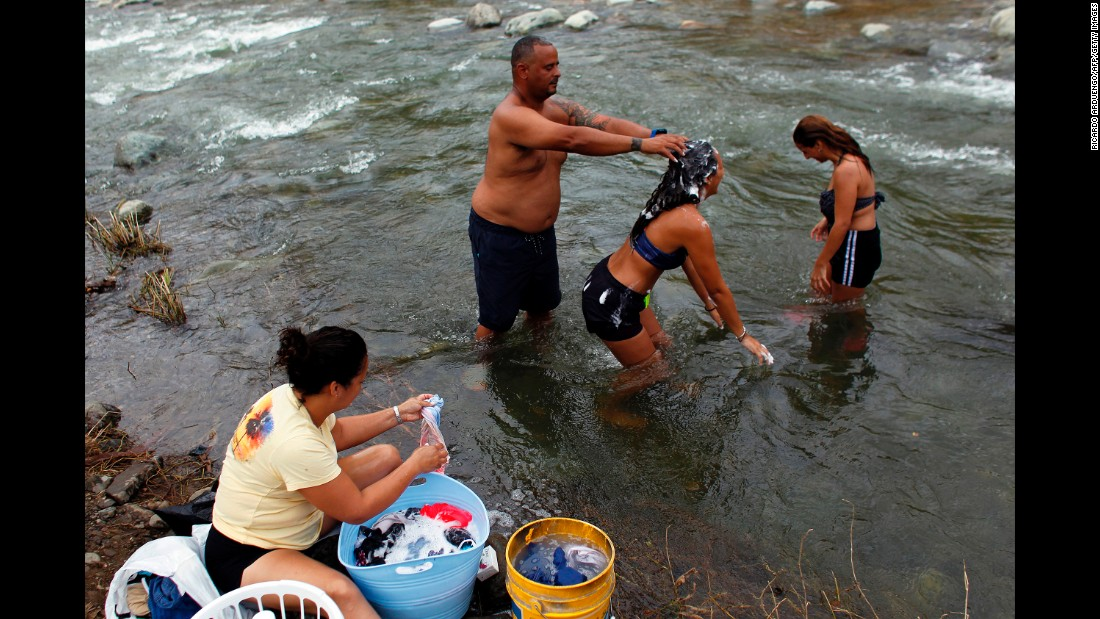 "A family bathes in the Cuyon River a week after the passage of <a href=""http://www.cnn.com/2017/09/28/us/puerto-rico-maria-by-the-numbers-trnd/index.html"" target=""_blank"">Category 4 Hurricane Maria</a> in Coamo, Puerto Rico, on Wednesday, September 27. <a href=""http://www.cnn.com/interactive/2017/09/us/puerto-rico-after-maria-cnnphotos/index.html"" target=""_blank"">Picking up the pieces</a>: Photos show how Puerto Ricans are coping in the aftermath of Hurricane Maria"
