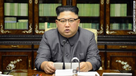 TOPSHOT - This picture taken on September 21, 2017 and released from North Korea's official Korean Central News Agency (KCNA) on September 22 shows North Korean leader Kim Jong-Un delivering a statement in Pyongyan as regards to a speech made by the president of the United States of America at the UN General Assembly.