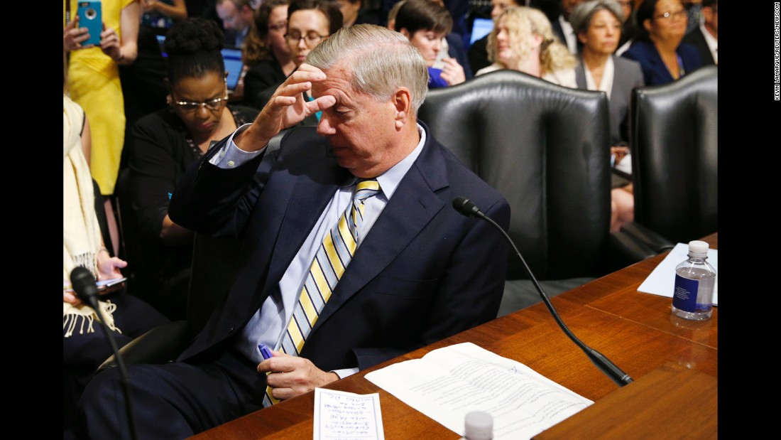 "Sen. Lindsey Graham waits at the witness table as disability-rights activists are removed by Capitol Hill police during a Senate Finance Committee hearing on the Graham-Cassidy bill in Washington on Monday, September 25. The Senate <a href=""http://www.cnn.com/2017/09/26/politics/health-care-republican-senate-vote/index.html"" target=""_blank"">will not vote on the Graham-Cassidy bill</a> to repeal Obamacare, Republican leaders announced Tuesday, dealing a devastating blow to President Donald Trump and GOP lawmakers who tried to make a last-ditch attempt to deliver on the party's yearslong campaign promise."