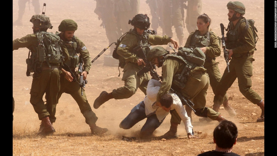 "Israeli security forces take a Palestinian man into custody during a protest against the Israeli barrier wall and Jewish settlements in the village of Khirbet Atuf in Tubas, West Bank, on Wednesday, September 27. <a href=""http://www.cnn.com/2017/05/03/politics/israel-two-state-explainer/index.html"" target=""_blank"">The Israeli-Palestinian conflict: What you need to know</a>"