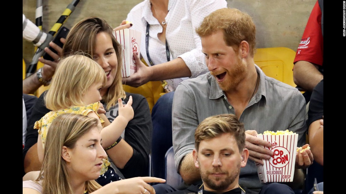 "Prince Harry sits with Hayley Henson, left, and her daughter Emily Henson during the Invictus Games in Toronto, Ontario, on Wednesday, September 27. Hayley is married to British paralympian David Henson, and the pair's 2-year-old daughter was spotted <a href=""http://news.sky.com/story/sneaky-toddler-steals-prince-harrys-popcorn-at-invictus-games-11057165"" target=""_blank"">trying to sneak some of Prince Harry's popcorn</a>."