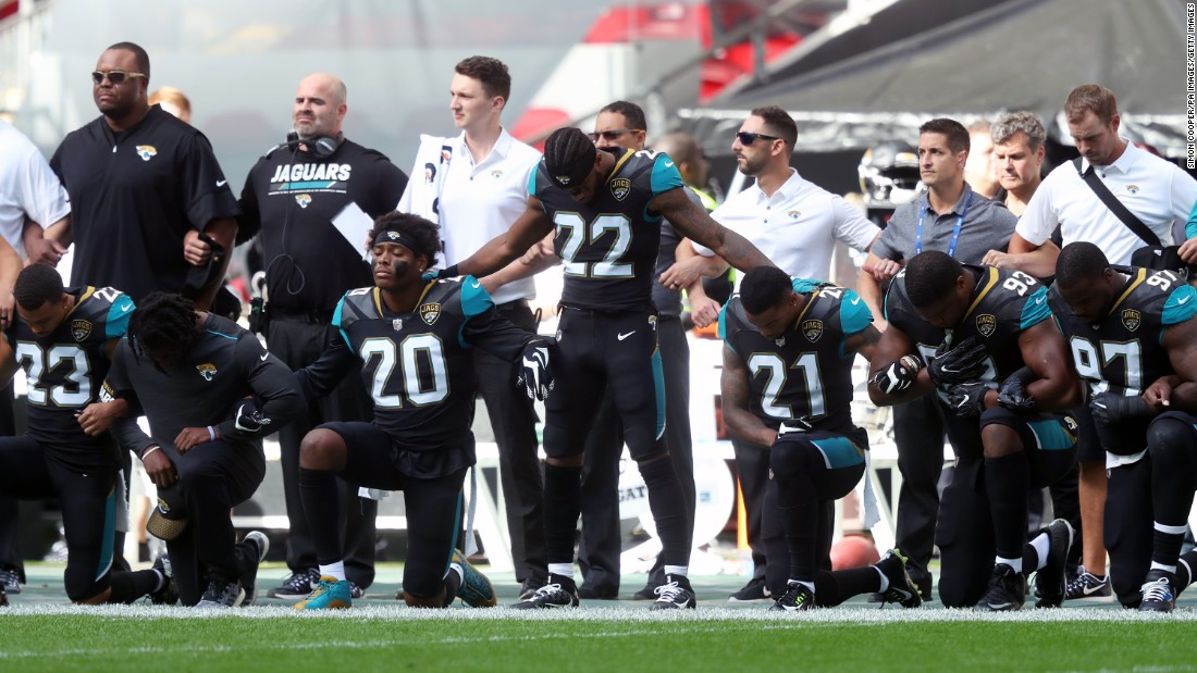 "Jacksonville Jaguars football players kneel in protest during the National Anthem before an NFL International Series match at Wembley Stadium in London on Sunday, September 24. <a href=""http://www.cnn.com/interactive/2017/09/us/nfl-anthem-protests-cnnphotos/index.html"" target=""_blank"">Not just a knee: Photos from Sunday's anthem protests</a>"