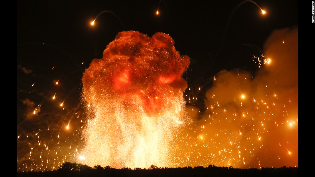 "A powerful explosion is seen in the ammunition depot of a military base in Kalynivka, west of Kiev, Ukraine, early Wednesday, September 27. <a href=""http://www.reuters.com/article/us-ukraine-explosions/thousands-evacuated-in-ukraine-as-ammunition-depot-explodes-idUSKCN1C20F1?il=0"" target=""_blank"">According to Reuters</a>, the massive explosions and a blaze forced authorities to evacuate 24,000 people and close airspace over the region, officials said on Wednesday."