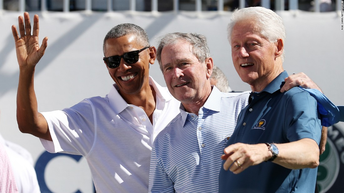 Former US Presidents Barack Obama, left, George W. Bush and Bill Clinton attend a trophy presentation during the Presidents Cup at Liberty National Golf Club in Jersey City, New Jersey, on Thursday, September 28.