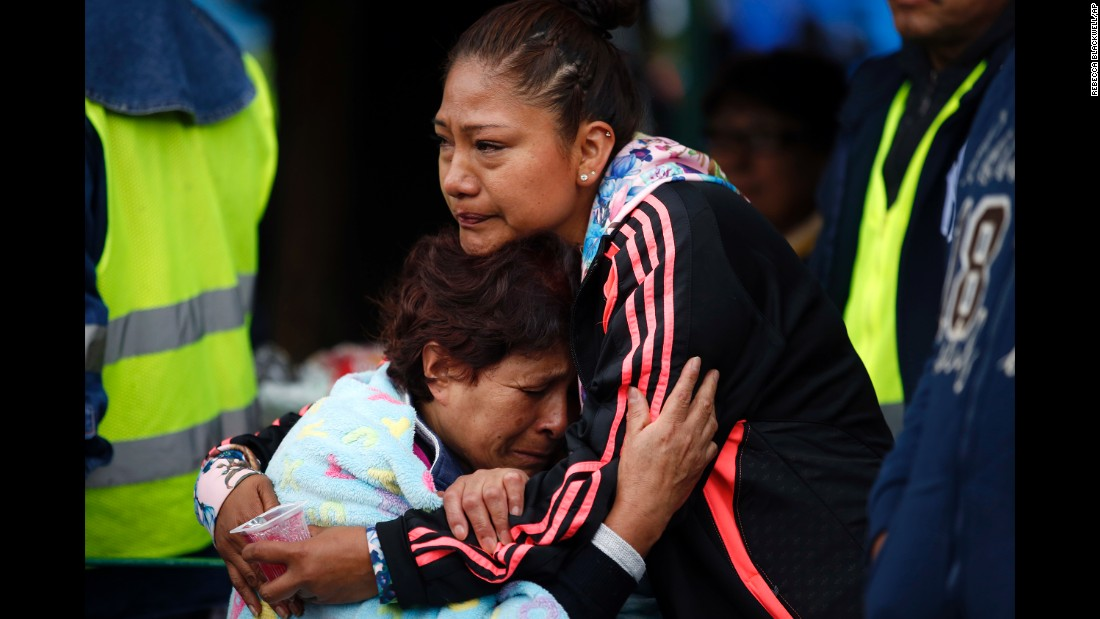 "Family members embrace as they wait for news of their relatives outside a collapsed seven-story building in Mexico City's Roma Norte neighborhood on Friday, September 22. <a href=""http://www.cnn.com/2017/09/19/americas/mexico-earthquake/index.html"" target=""_blank"">A 7.1 magnitude earthquake</a> destroyed parts of Mexico City and surrounding states just days before. <a href=""http://www.cnn.com/interactive/2017/09/world/mexico-earthquake-rescuers-cnnphotos/index.html"" target=""_blank"">Meet the volunteers helping after Mexico's quake</a>"