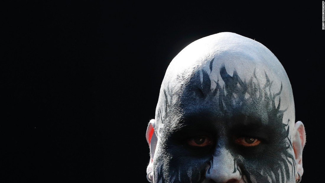 A man looks on during the International Tattoo Convention in London on Friday, September 22. The convention hosts more than 400 of the most prominent and talented tattoo artists on the planet, showcasing their skills and styles in public.