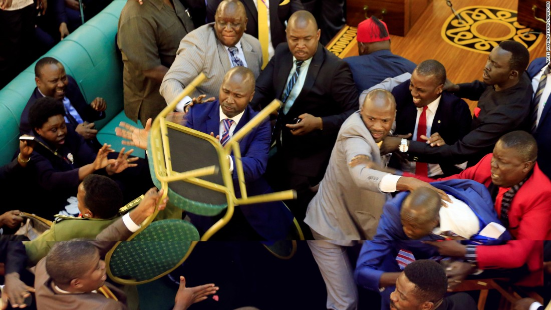 "A brawl breaks out between Ugandan lawmakers during an age-limit debate in Kampala, Uganda, on Tuesday, September 26. <a href=""https://www.washingtonpost.com/news/worldviews/wp/2017/09/28/ugandan-lawmakers-brawled-over-the-presidents-effort-to-extend-his-rule-now-broadcasting-parliamentary-hearings-is-illegal/?utm_term=.b888a2b659fe"" target=""_blank"">According to The Washington Post</a>, ""the fight exposed the bitter rift between lawmakers who support President Yoweri Museveni's efforts to extend his rule and those who oppose it."" Museveni, who is now 73, has been president of Uganda for 31 years."