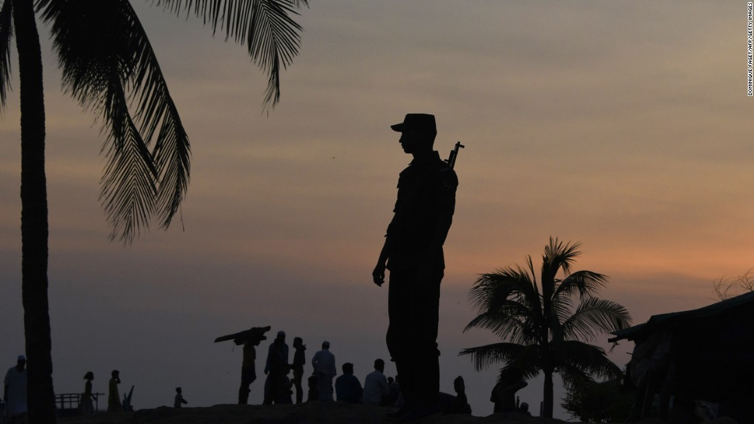 A Bangladeshi border guard keeps watch on September 16, near the beach of Sharapuri Dwip, where many Rohingya refugees land after crossing from Myanmar.