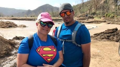 Maritza Rivera with her husband. They crossed the river to walk two hours to the nearest supermarket to buy bread and rice.
