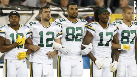 Green Bay Packers link arms during the national anthem before an NFL football game against the Chicago Bears Thursday, Sept. 28, 2017, in Green Bay, Wis. (AP Photo/Matt Ludtke)