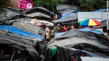 Rohingya Muslim refugees line up in Kutupalong refugee camp in the Bangladeshi district of Ukhia on September 28, 2017.  The UN has drawn up a contingency plan to feed up to 700,000 Muslim Rohingya refugees from Myanmar after some 480,000 fled to Bangladesh over the past month and arrivals continue. A senior official from the UN's World Food Program (WFP) told AFP they were now prepared to provide massive food and other emergency aid if the influx continues in coming weeks. / AFP PHOTO / FRED DUFOUR        (Photo credit should read FRED DUFOUR/AFP/Getty Images)