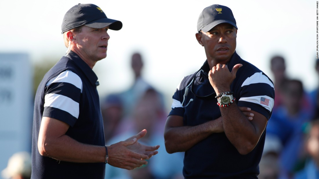 Fourteen-time major winner Tiger Woods -- pictured talking to US Team  captain Steve Stricker -- is an assistant in the American team, along with Fred Couples, Davis Love and Jim Furyk.
