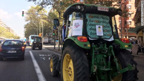 Tractors drive through Barcelona's streets on Friday in support of Sunday's independence referendum.