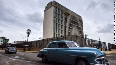 Picture of the US embassy in Havana, taken on September 29, 2017 after the United States announced it is withdrawing more than half its personnel in response to mysterious health attacks targeting its diplomatic staff. Secretary of State Rex Tillerson said Washington would maintain relations with Havana -- which were only fully restored in 2015, and which have deteriorated since President Donald Trump took office earlier this year. Routine visa operations will be suspended indefinitely in response to the attacks, which are of an unknown nature have targeted at least 21 US embassy staff over the past few months. / AFP PHOTO / Adalberto ROQUE        (Photo credit should read ADALBERTO ROQUE/AFP/Getty Images)