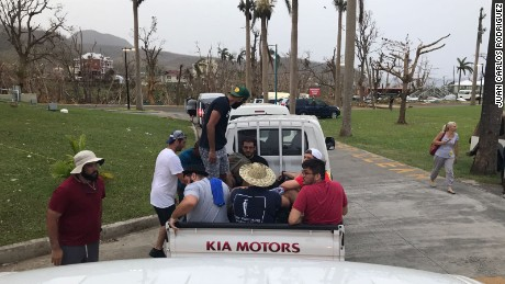 Students and faculty members evacuate from Ross University School of Medicine in Dominica.