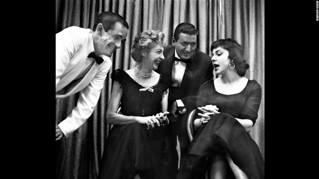 "Monty Hall is pictured in an early rehearsal of ""Keep Talking,"" a CBS television comedy game show in New York on June 27, 1958. Pictured from left are Danny Dayton, Ilka Chase, host Monty Hall, Elaine May."