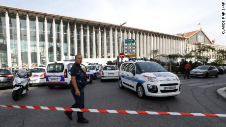 A French police officer cordons off Marseille's Saint-Charles train station on Sunday.