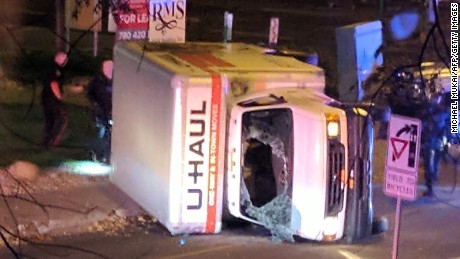 "A rental truck lies on its side in Edmonton, Canada, on October 1, 2017, after a high speed chase. Canadian police arrested a man early Sunday suspected of stabbing an officer and injuring four pedestrians in a series of violent incidents being investigated as an ""act of terrorism."" The crime spree began late September 30 outside a football stadium and ended hours later with a high speed chase in which the driver of the rented truck plowed into pedestrians, police said.  / AFP PHOTO / Michael MUKAI        (Photo credit should read MICHAEL MUKAI/AFP/Getty Images)"