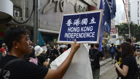 A pro-independence activist marches in Hong Kong's Admiralty district on October 1.