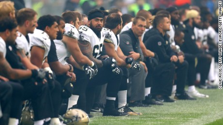 New Orleans Saints players and team kneel prior to the NFL match between New Orleans Saints and Miami Dolphins at Wembley Stadium