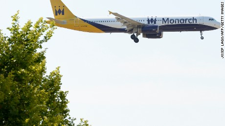 An airplane of the British low-cost airline Monarch prepares to land at Barcelona's airport in El Prat de Llobregat on June 6, 2016.