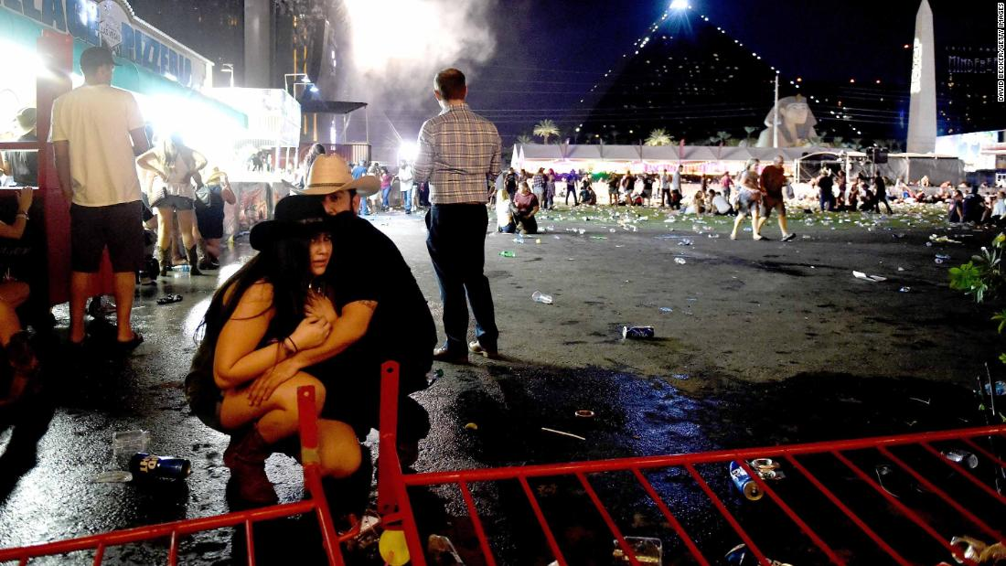 "A couple huddles after shots rang out at a country music festival on the Las Vegas Strip on Sunday, October 1. At least 58 people were killed and almost 500 were injured when <a href=""http://www.cnn.com/2017/10/02/us/las-vegas-shooter/index.html"" target=""_blank"">a gunman opened fire</a> on the crowd. Police said the gunman, 64-year-old Stephen Paddock, fired from the Mandalay Bay hotel, several hundred feet southwest of the concert grounds. He was found dead in his hotel room, and authorities believe he killed himself and that he acted alone. It is the deadliest mass shooting in modern US history."