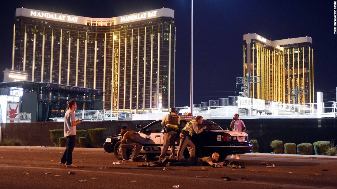 Police take position outside the Mandalay Bay.