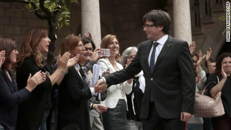 Catalan President Carles Puigdemont shakes hands with workers of the Government of Catalonia before a government meeting at the Palau Generalitat in Barcelona, Spain, Monday, Oct. 2, 2017. Catalonia's government will hold a closed-door Cabinet meeting Monday to discuss the next steps in its plan to declare independence from Spain following a disputed referendum marred by violence. (AP Photo/Manu Fernandez)