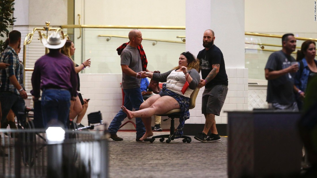 A woman is moved outside the Las Vegas Tropicana resort. Multiple victims were being transported to hospitals in the aftermath of the shooting.