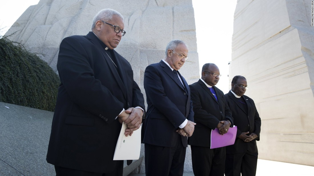 "A moment of silence is held at the Martin Luther King Jr. Memorial in Washington during an event honoring the 60th anniversary of King's essay, ""Nonviolence and Racial Justice."""