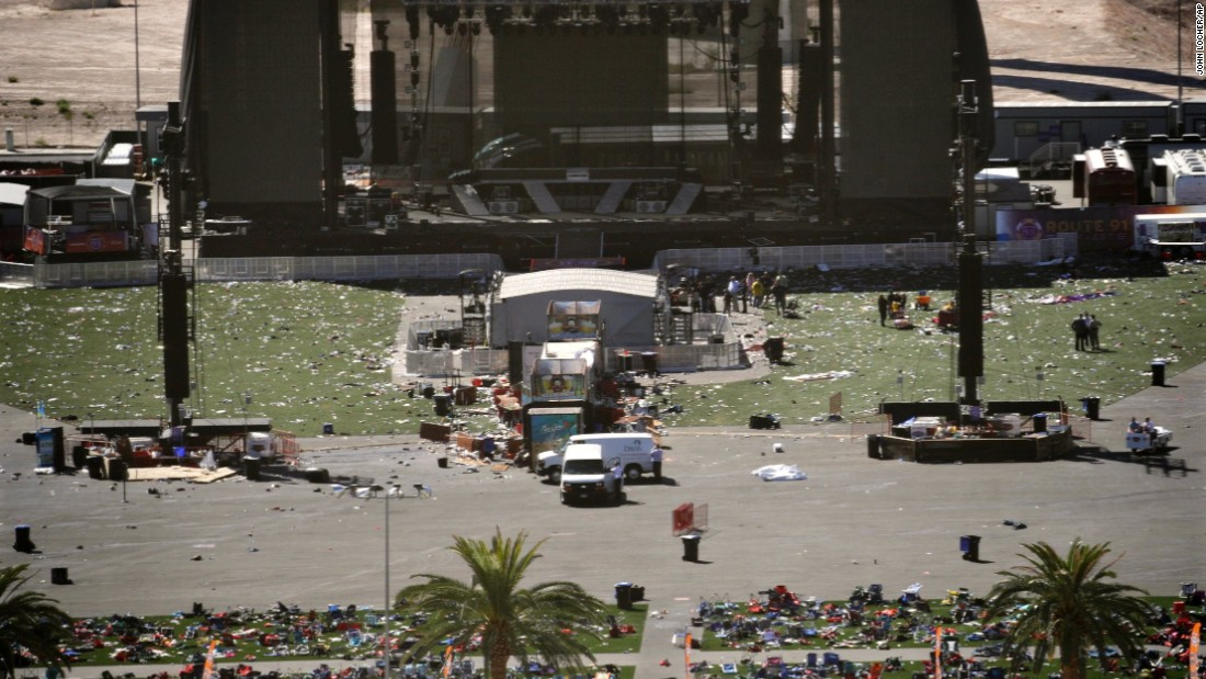 "Debris is scattered on the ground Monday, October 2, at the site of a country music festival held this past weekend in Las Vegas. Dozens of people were killed and hundreds were injured Sunday when <a href=""http://www.cnn.com/2017/10/02/us/las-vegas-shooter/index.html"" target=""_blank"">a gunman opened fire</a> on the crowd. Police said the gunman fired from the Mandalay Bay hotel, several hundred feet southwest of the concert grounds. It is the deadliest mass shooting in modern US history."