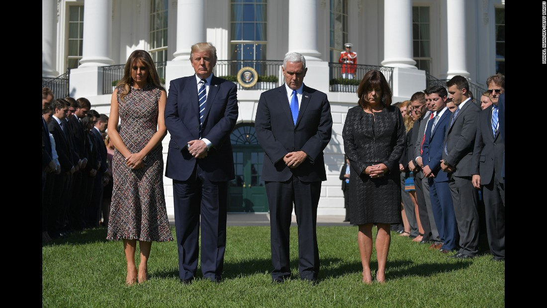 From left, first lady Melania Trump, US President Donald Trump, Vice President Mike Pence and Pence's wife, Karen, take part in a moment of silence at the White House on October 2.